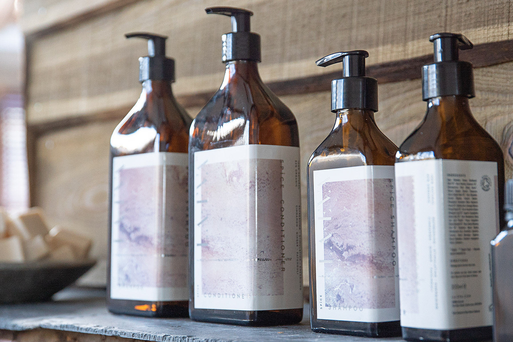 Row of La Eva soap bottles, Spice shampoo