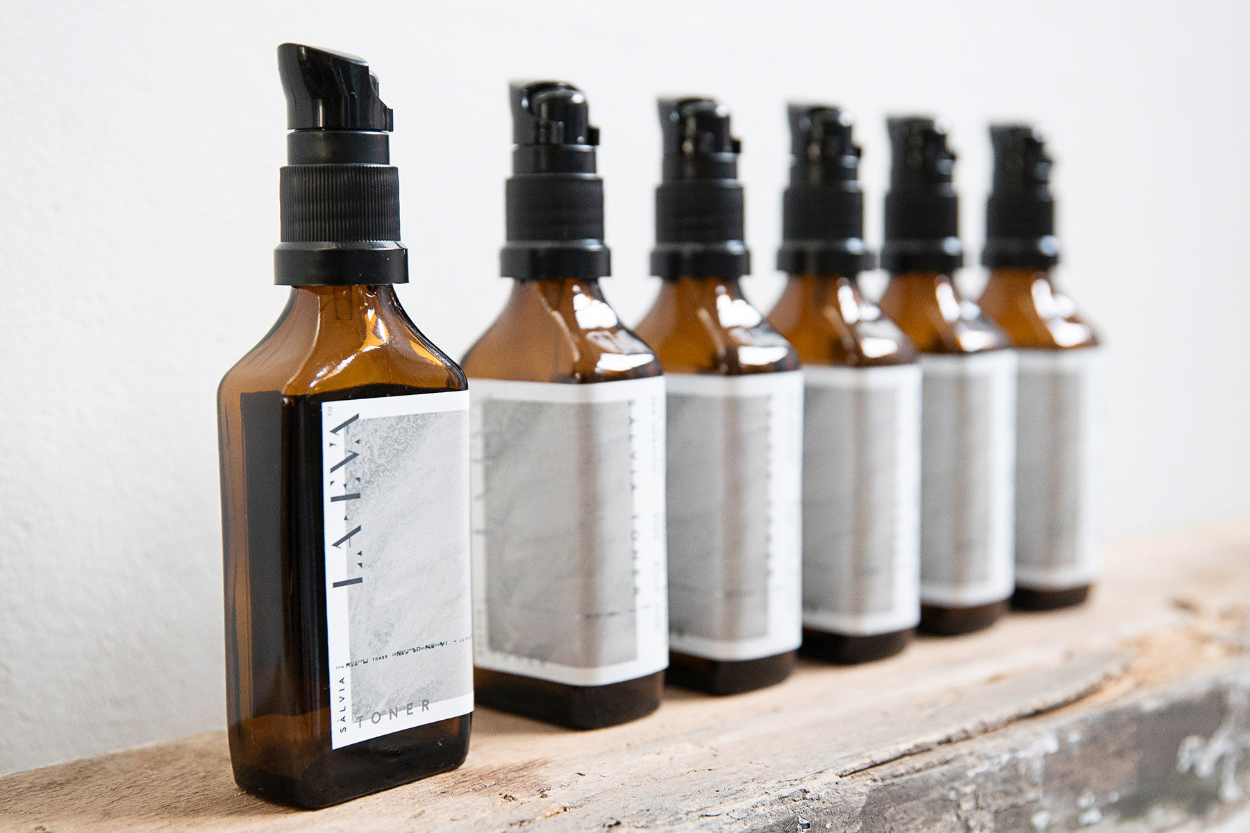 Row of La Eva, small salvia toner bottles
